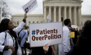 Demonstrators from Doctors for America marched in support of the Affordable Care Act outside the U.S. Supreme Court in March 2015.
